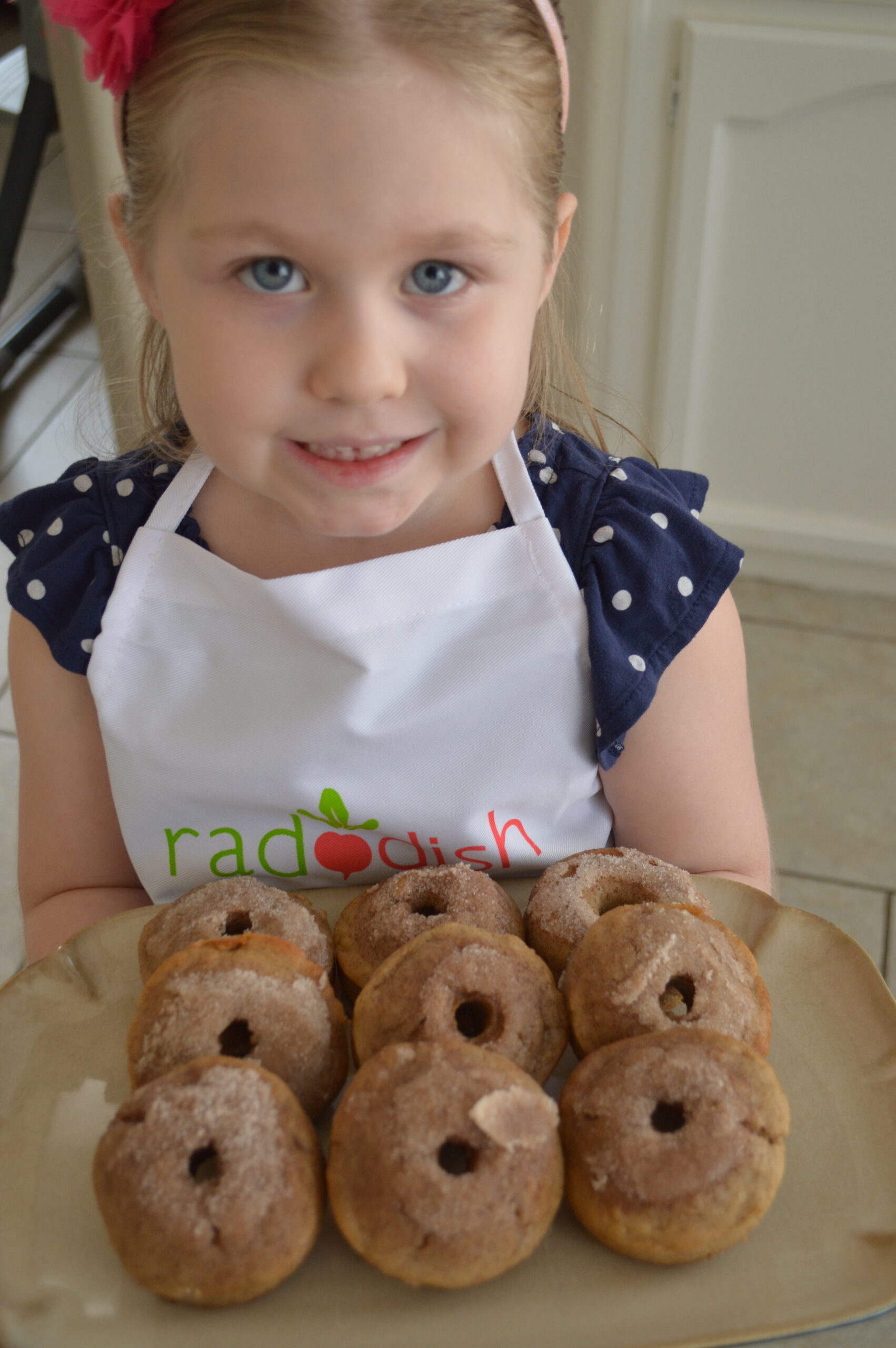 kid holding raddish kids donuts kit