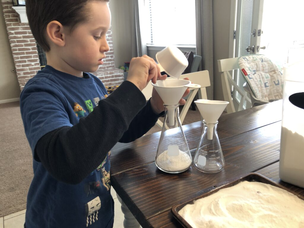 Kid mixing baking soda and vinegar in a glass bottle