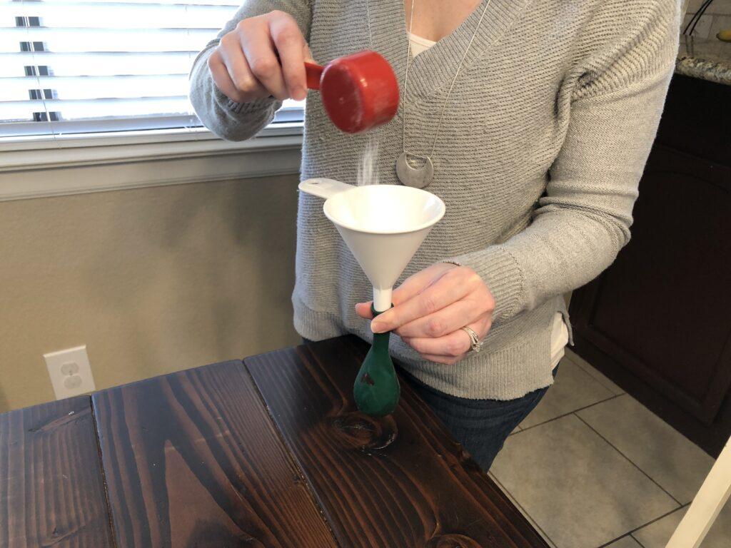 adding baking soda to the balloon