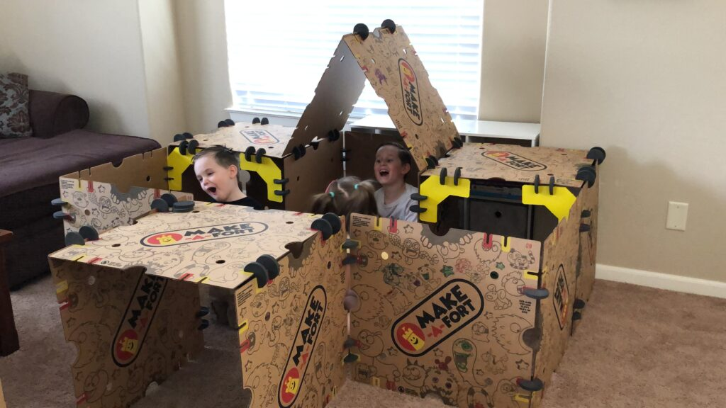 Kids playing together in a fort